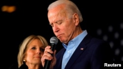 FILE - Democratic presidential candidate and former Vice President Joe Biden is accompanied by his wife Dr. Jill Biden as he addresses supporters at a rally at the Drake University Olmsted Center in Des Moines, Iowa, Feb. 3, 2020.
