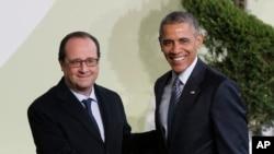 2015年11月30号法国总统奥朗德(左)欢迎美国总统奥巴马参加巴黎联合国气候大会。