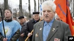 Chernobyl veterans walk during a rally in Kiev, Ukraine, Sunday, April 17, 2011.