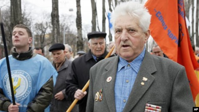 Chernobyl veterans walk during a rally in Kiev, Ukraine, Sunday, April 17, 2011.