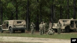 This image made from a video shows soldiers on Fort Bragg, N.C., Sept. 14, 2017. A training exercise involving demolitions turned deadly at the Army's largest base Thursday, killing one soldier and injuring several. Soldiers pictured were not involved in