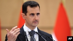In this photo dated June 20, 2011 and released by the Syrian official news agency SANA, Syrian President Bashar Assad delivers a speech in Damascus, Syria, at Damascus University.