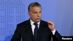 FILE - Hungarian Prime Minister Viktor Orban delivers a speech in Budapest, Hungary, Sept. 7, 2015.
