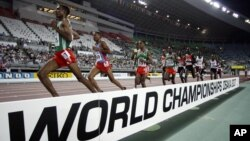 Ethiopia's Gbre-gziabher Gebrmariam, left, leads ahead of Eritrea's Zerenay Tadese, 2nd left, and Ethiopia's Kenenisa Bekele during Men's 10,000 meters race at the World Athletics Championships in Osaka, Japan, August 27, 2007.