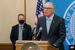 Washington Gov.  Jay Inslee speaks at a news conference at the Capitol in Olympia on August 18, 2021.