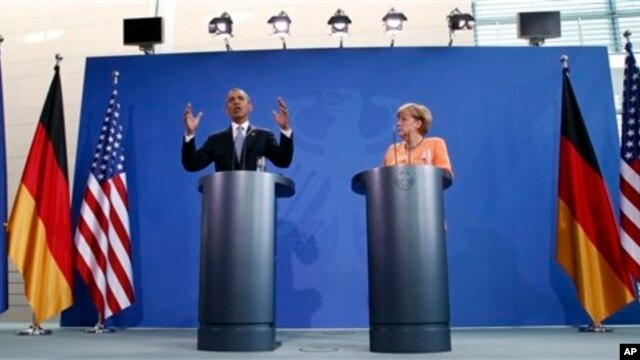 U.S. President Barack Obama and German Chancellor Angela Merkel address media, Berlin, June 19, 2013.