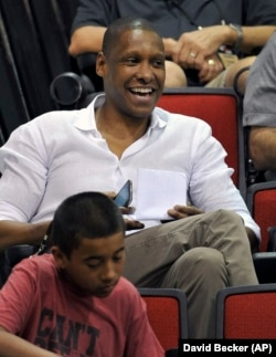 Toronto Raptors general manager Masai Ujiri watches his team play against Denver Nuggets during an NBA summer league basketball game on Saturday, July 12, 2014, in Las Vegas. Ujiri is from Nigeria.