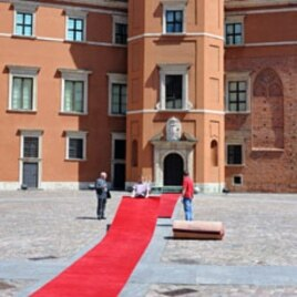 Workers prepare a red carpet in the Royal Castle courtyard one day ahead of the Central and East Europe Presidents summit, in Warsaw, May 26, 2011