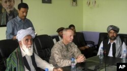 The commander of U.S. and NATO troops in Afghanistan, General John Allen (C) meets with the Governor of Logar Province, Allhaj Mohammad Tahir Sabari (L) south of Kabul, Afghanistan, June 8, 2012.