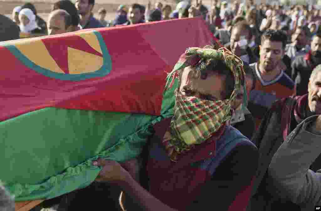 Plus de 20 frappes a riennes koban en syrie for Combat portent 2014