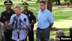 Boston Mayor Marty Walsh (R) holds a news conference with William Evans, Boston Police commissioner, in the Boston Commons in Boston, Massachusetts, Aug. 19, 2017.