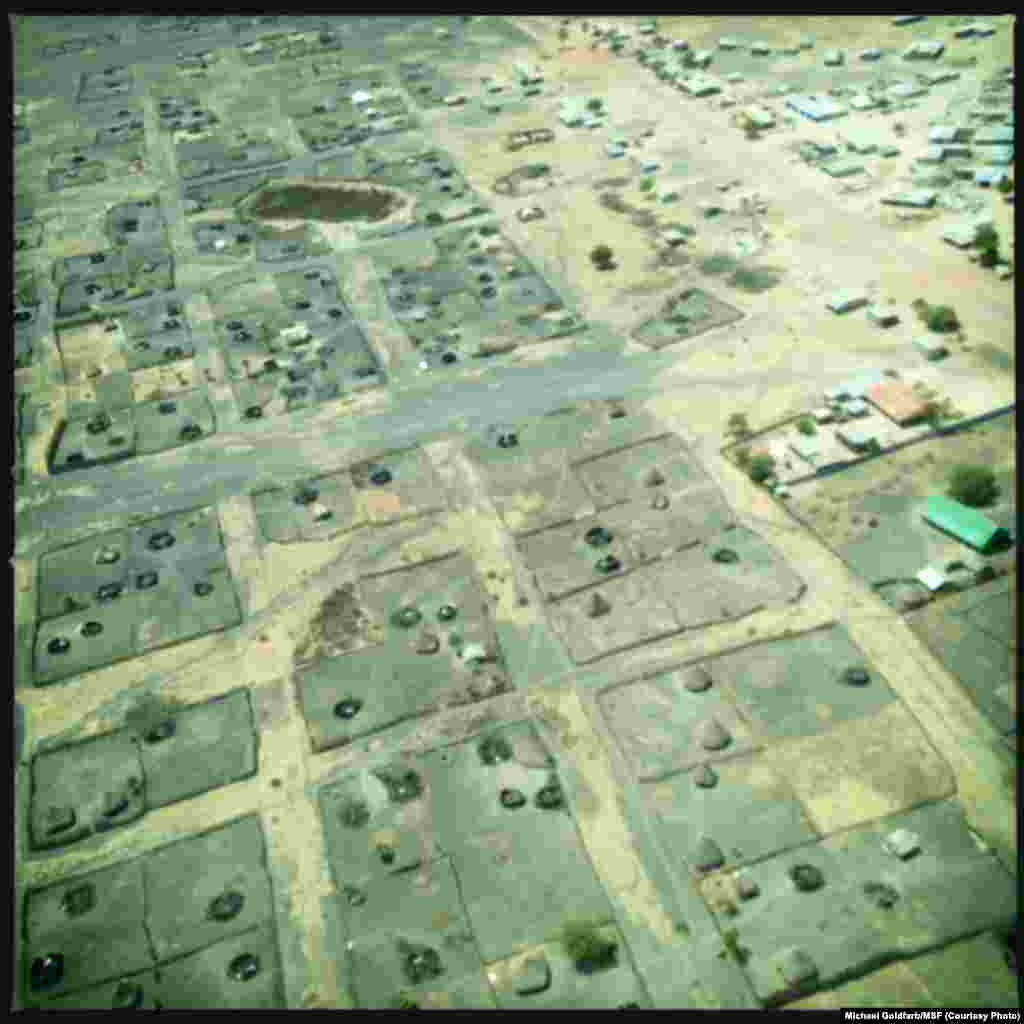 An aerial shot taken over Leer in Unity state, South Sudan, shows many tukuls burnt to the ground.