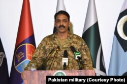 FILE - Major General Asif Ghafoor addresses a press conference on July 16, 2017. Military's media wing ISPR has released the photo to news organizations, including VOA.