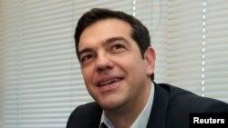 Alexis Tsipras a vu dimanche le triomphe de son parti anti-austérité, Syriza (Reuters)