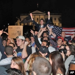 A crowd of mostly young Americans have gathered in front of the White House after President Obama's announcement of the death of Osama bin Laden, at 2:00am on Monday, May 02, 2011