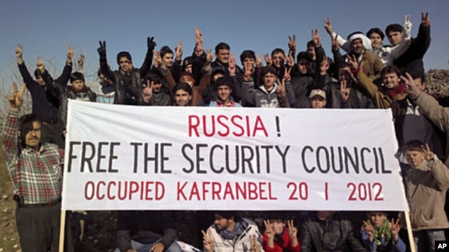 Demonstrators gather during a protest against Syria's President Bashar al-Assad and Russia in Kafranbel near Idlib, January 20, 2012