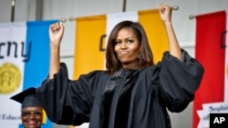 FILE - First lady Michelle Obama reacts to cheers from the class of 2016 during commencement for City College of New York, June 3, 2016.