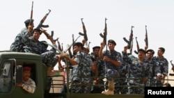 Voluntários xiitas que se juntaram aos militares iraquianos na sua guerra contra o Estado Islâmico do Iraque e do Levante - ISIL (Bagdad, 18 Junho 2014)