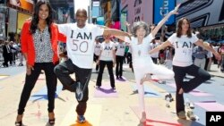 Pfizer's Get Old Initiative. Tao Porchon-Lynch teaches yoga to hundreds in Times Square, NYC. (Brian Ach/AP Images forPfizer)