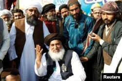 Khadim Hussain Rizvi, center, leader of Tehreek-e-Labbaik Pakistan islamist political party, at their protest site in Islamabad, Pakistan, Nov. 27, 2017.