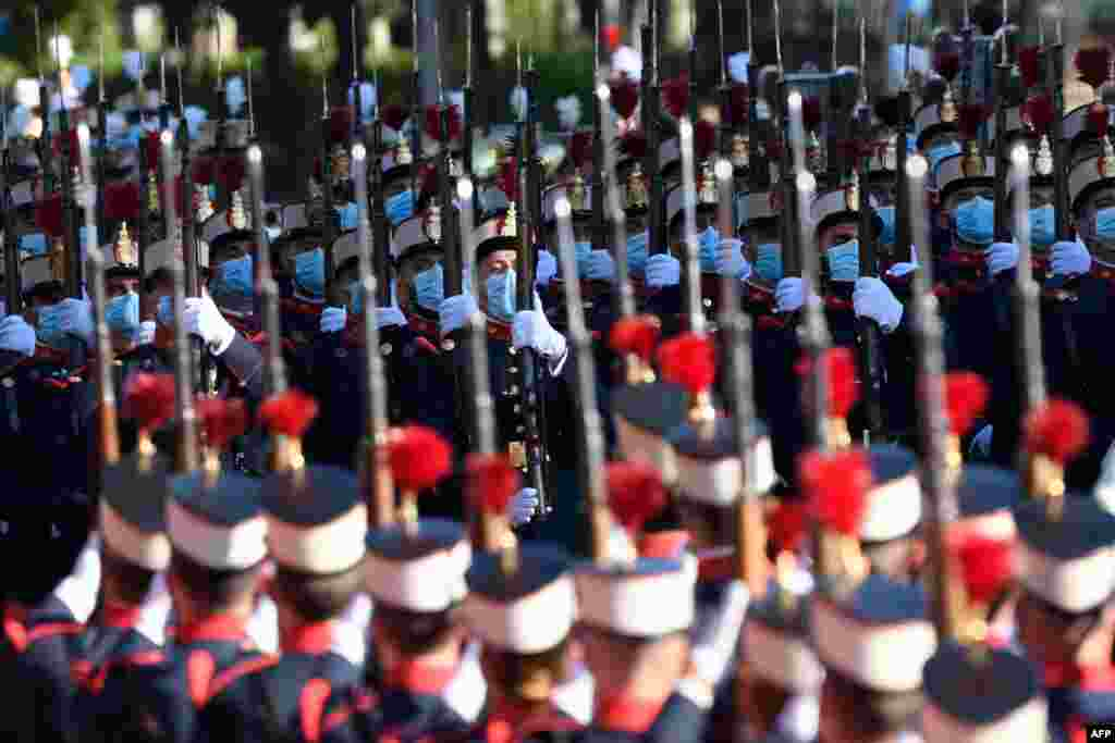 Spanish troops march during the Spanish National Day military parade in Madrid.