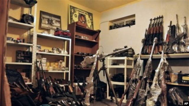 An arsenal containing grenades, grenade launchers, assault riffles and other high-powered weapons are stored inside a basement warehouse in the city of Ciudad Juarez, Mexico, April 29, 2011