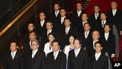 Japan's new Prime Minister Yoshihiko Noda, front row center, and some of his Cabinet members stand together during an official photo session following their first Cabinet meeting at the prime minister's official residence in Tokyo, September 2, 2011.