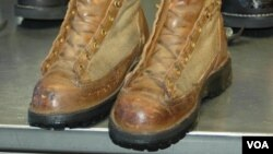 VOA correspondent Steve Herman's boots before being repaired after almost 25 years of wear. (Steve Herman/VOA)
