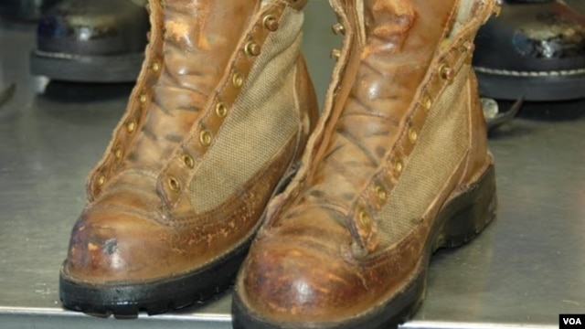 VOA correspondent Steve Herman's boots, before recrafting, after nearly a quarter century of wear. (Steve Herman/VOA)