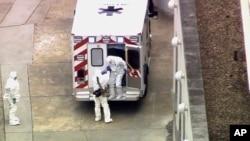 An ambulance arrives with Ebola victim Dr. Kent Brantly at Emory University Hospital on Aug. 2, 2014.