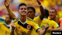 19일 열린 브라질 월드컵 조별리그 콜롬비아와 코트디부아르의 경기에서 콜롬비아 하메스 로드리게스가 선제골을 넣은 뒤 환호하고 있다.