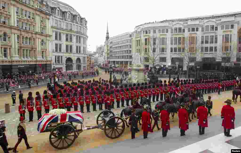 The coffin of former British Prime Minister Margaret Thatcher, draped in the Union Flag, is carried on a gun carriage drawn by the King's Troop Royal Artillery during her funeral procession in London, April 17, 2013. Thatcher, who was Conservative prime minister between 1979 and 1990, died on April 8 at the age of 87.