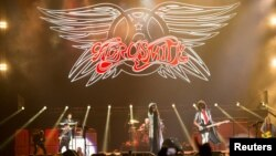 "FILE - Rock band Aerosmith performs during the ""Aerosmith: Let Rock Rule"" tour at The Forum in Inglewood, California, July 30, 2014."