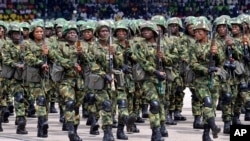 Nigerian soldiers march during 58th anniversary celebrations of Nigerian independence, in Abuja, Nigeria, Monday, Oct. 1, 2018. (AP Photo/Olamikan Gbemiga)