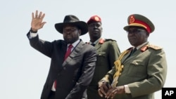 FILE - South Sudan's President Salva Kiir, accompanied by then-Army Chief of Staff Paul Malong, waves during an independence day ceremony in Juba, South Sudan, July 9, 2015.