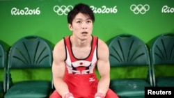 Japanese gymnast Kohei Uchimura pauses during a workout at the Rio Olympic Arena in Rio de Janeiro, Aug. 3, 2016.