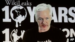 WikiLeaks founder Julian Assange participates via video link at a news conference marking the 10th anniversary of the secrecy-spilling group in Berlin, Germany, Tuesday, Oct. 4, 2016. Assange said that WikiLeaks plans to start a series of publications thi
