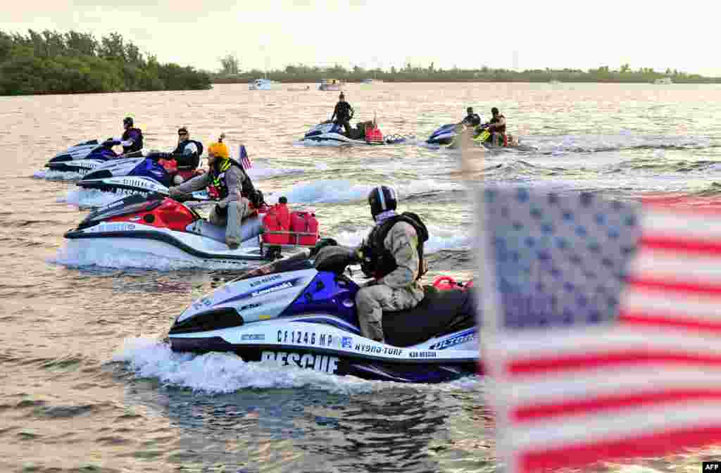 In this photo released by the Florida Keys News Bureau, combat veterans, aboard personal watercraft, leave Key West, Florida, USA, headed to New York City for a planned arrival on September 11. The approximately 1,600-mile (2,575-km) Never Quit Challenge voyage is to benefit three charities that assist military members, veterans and their families.