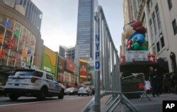 Crowd barriers are in place around Macy's as preparations continue for the Macy's Thanksgiving Day Parade in New York, Nov. 23, 2016, More than 80 New York City sanitation trucks filled with sand will be used along the route to create a physical barrier along the route.