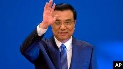 2014年3月13日中国国务院总理李克强在人民大会堂新闻发布会(资料照片)