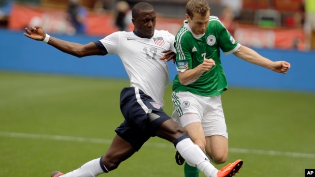 U.S. forward Jozy Altidore (17) and Germany defenseman Marcell Jansen (7) go for the ball during the first half of an international friendly soccer match at RFK Stadium, June 2, 2013, in Washington.