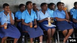 Malawi girls relax after a session at the Girls' Club in Mulanje, Malawi. (Photo: Lameck Masina for VOA)