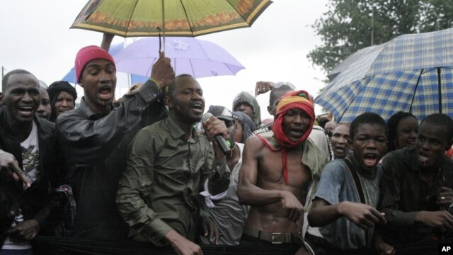 People originally from Mali's north protest in the rain against the Islamist takeover of northern Mali, in the capital, Bamako, Mali, July 4, 2012.