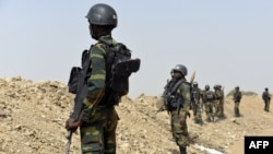 FILE - A picture taken on February 17, 2015 shows Cameroonian soldiers patrolling in the Cameroonian town of Fotokol, on the border with Nigeria, after clashes occurred between Cameroonian troops and Nigeria-based Boko Haram insurgents.