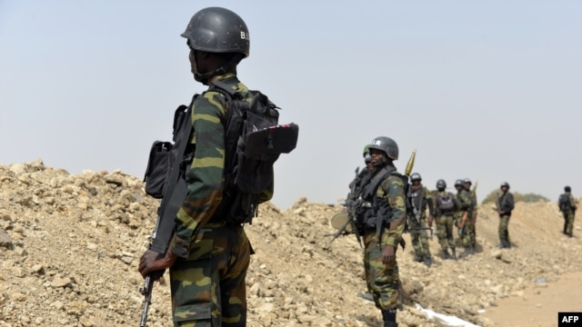 FILE - A picture taken on February 17, 2015 shows Cameroonian soldiers patrolling in the Cameroonian town of Fotokol, on the border with Nigeria. A spokesman for the government of Cameroon said more than 160 Boko Haram fighters were killed and hundreds of hostages, both Cameroonian and Nigerian, freed in the liberation of Goshi.