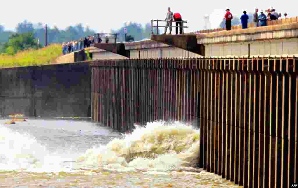 Members of the U.S. Army Corps of Engineers open the Morganza Spillway in Morganza, Louisiana. (Reuters/Sean Gardner)