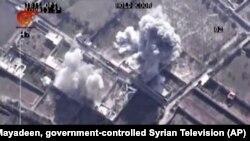 Cuma günü Suriyeli isyancı lider Zehran Alluş'un öldürüldüğü hava saldırısının insansız hava aracından çekilen görüntüsü