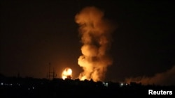 An explosion is seen following an Israeli airstrike in the southern Gaza Strip, July 20, 2018.