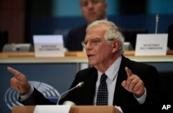 FILE - Spanish Foreign Minister Josep Borrell answers questions at the European Parliament in Brussels, Oct. 7, 2019.
