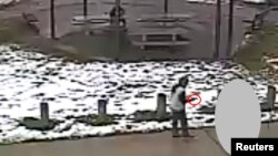 Tamir E. Rice, 12, is seen allegedly pointing a pellet gun at the Cudell Recreation Center in Cleveland, Ohio, in a still image from video released by the Cleveland Police Department Nov. 26, 2014.
